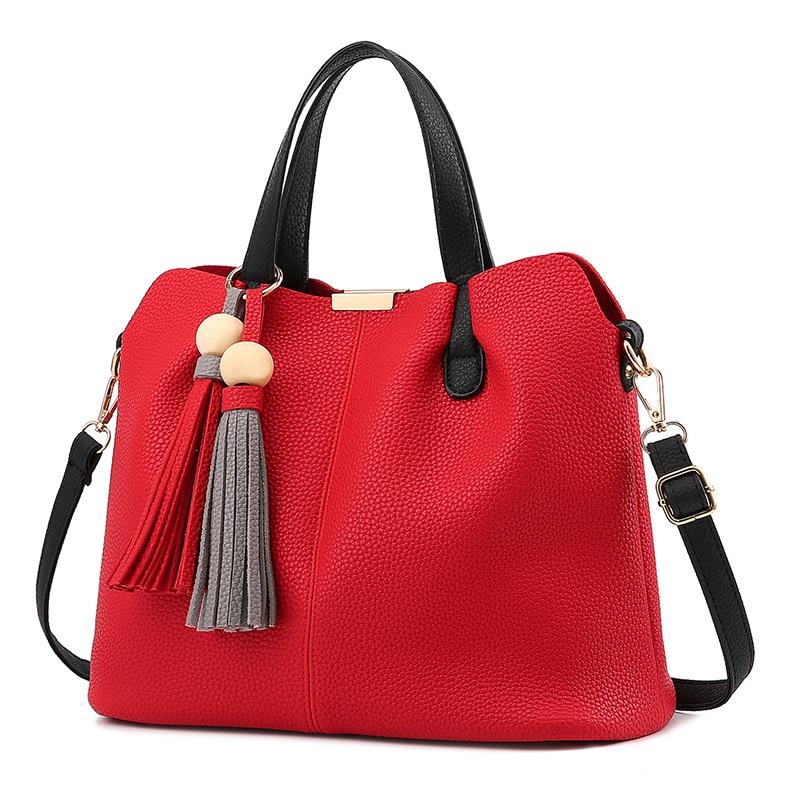 Tassel ornaments large capacity women handbag 2017 new pu soft bag solid color business shoulder bag
