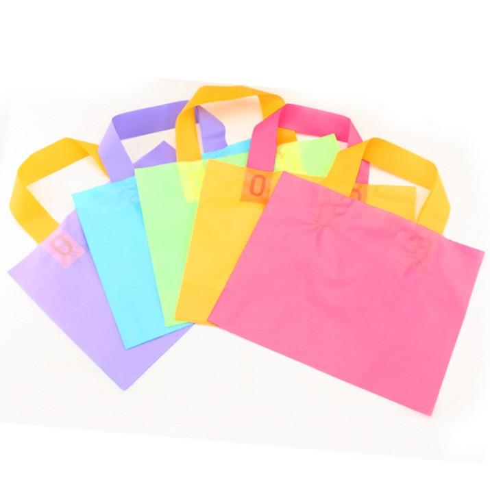 2018 New 50pcs 25+20+4cm Plastic gift bag Color cross plate garment bag Shopping make-up wrapper bag