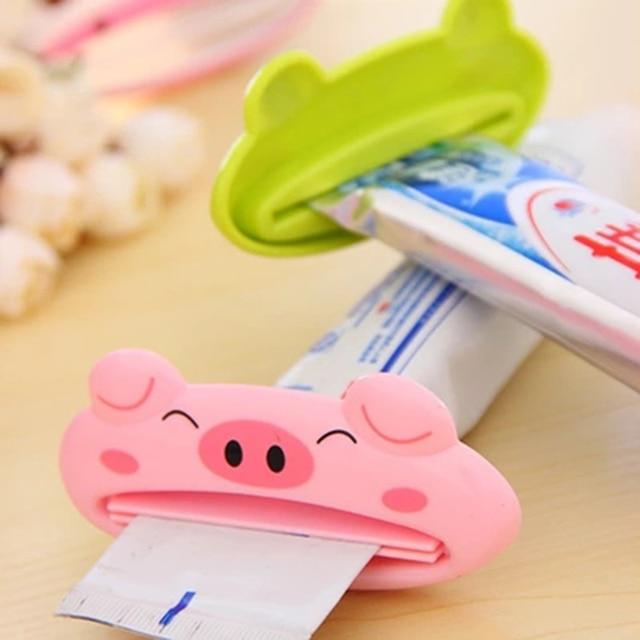 free shipping NEW 1pcs Bathroom Home Tube Rolling Squeezer Easy Cartoon Toothpaste Dispenser random colour