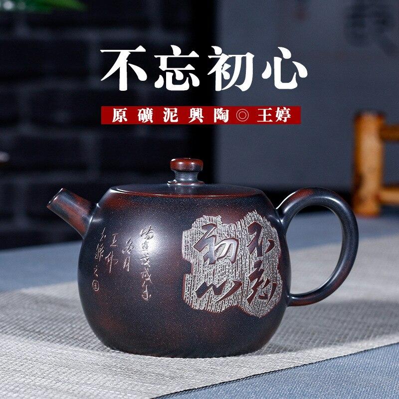 Théière en poterie émaillée rouge foncé en gros Yixing Wang Ting théière manuelle thé Kung Fu ont des cheveux de génération directe d'usine