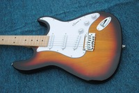 A real photo of the delicate yellow guitar.Vicers electric guitars