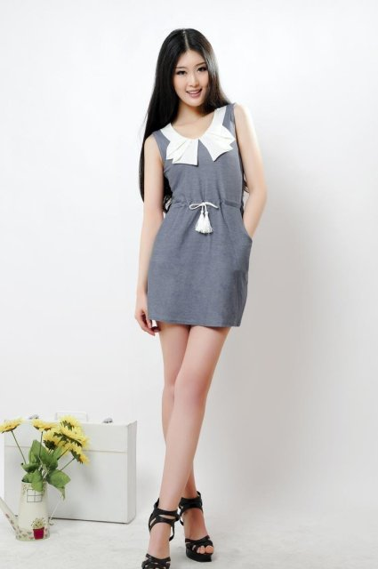 The new spring and summer 2012 pure cotton knitting tassel waist rope dress to report center