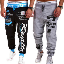 купить 2016 Male Letter Print Harem Pants Men Trousers Wear Mens Jogger Drawstring Elastic Waist Letter Loose Sweatpants Man Punk Pants по цене 836.28 рублей