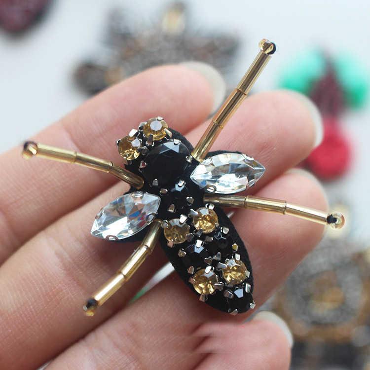 10 pz 4.5x3.3 cm nero api paillettes perline Strass appliques patch spille KMUY76I