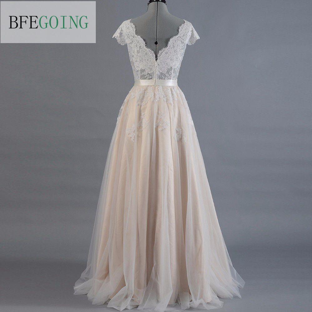 Vestido de novia lace a line wedding dress cap sleeve v for Capped sleeves wedding dress