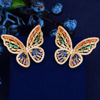 60c544375ac9 GODKI lujo Multicolor mariposa Stud aretes para las mujeres de la boda de  circón cúbico