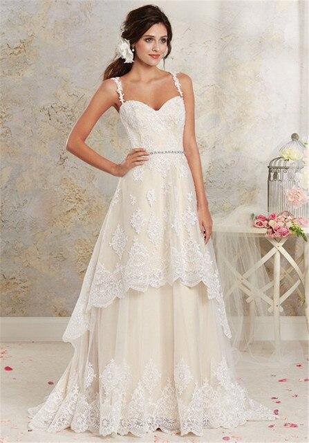 Delicately Romantic Lace Wedding Dress 8535 Tiered Hi Low Hemline Applique Champagne Bridal