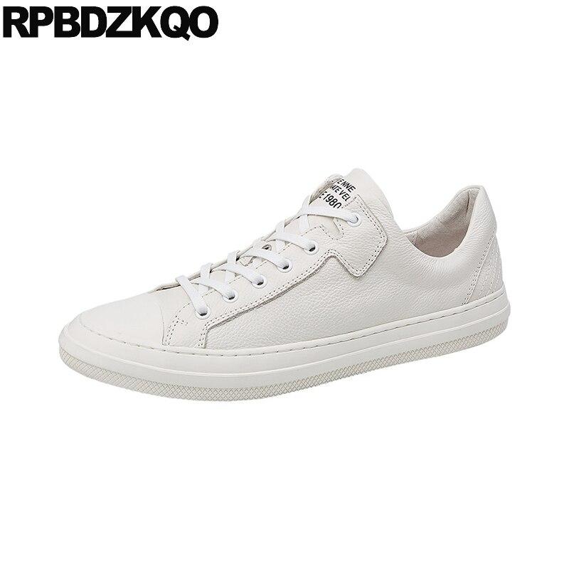 Printemps Hommes Cuir Qualité Haute Blanc Italien Piste Véritable Casual  Noir Nouveaux Luxe Lacent Sneakers Chaussures Skate blanc De Formateurs  Marque ... bd3b2c9e9d8a