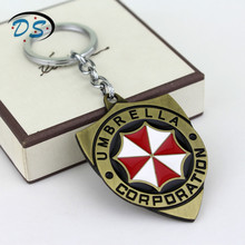 Movie Jewelry Resident Evil Keychain Umbrella Corporation Shield shape Key Ring for Car Key Bags Unique Accessories Key Chains