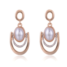 Купить с кэшбэком SUKI New Earrings Arrival 2018 Angel Eyes Big Simulated-pearl Glitter CZ Pave Pendant Stud Earring Women Summer Fashion Jewelry