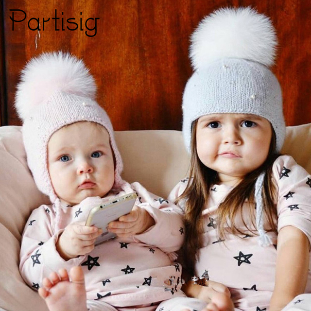 Baby Hat Winter Pearl Girls Cap Artificial Fur Ball Baby Boy Hats Infant  Earflap Caps Wool Knitted Children s Hats Caps For Kids 0c31f70634f