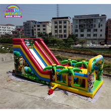 Commercial outdoor inflatable bouncers, animal paradise inflatable bouncy caslte with slide for sale