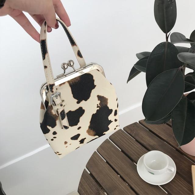 Bolsa de mão feminina com estampa de vaca, bolsa de ombro pequena pu de marca com clipe para mulheres