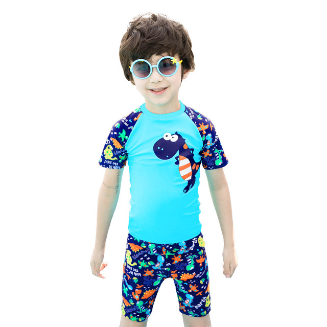 4fbba81df16e2 Children swimwear Baby dinosaur printing two piece swimsuit Knee length boys  swim trunks with shirts   cap Dinosaur swimsuit