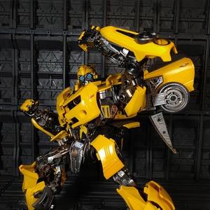 Image 4 - WJ Transformation MPM 03 MPM03 MPM 03 film dabeille jaune surdimensionné 28CM Version alliage Collection figurine Robot jouets cadeaux