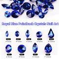 O Envio gratuito de New 100 pcs K9 Qualidade Swarovski Azul Royal Strass Pointback Vidro Strass Arte Do Prego Decoração Ouro Montagens Gif
