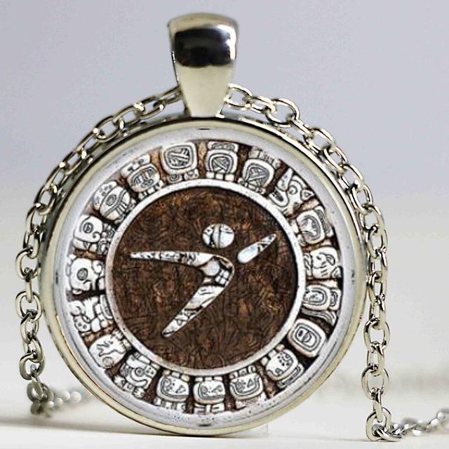 Aztec calendar necklace sun stone pendant jewelry the xiuhpohualli aztec calendar necklace sun stone pendant jewelry the xiuhpohualli the tonalpohualli glass cabochon necklace aloadofball Images