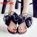 YMECHIC 2017 del verano de la señora Bowtie sandalias planas de la flor sexy femenina de moda casual flip-flop playa mujeres gris negro zapatos casa