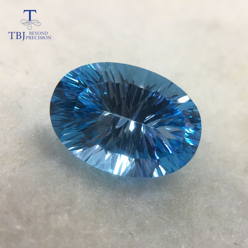 все цены на Tbj ,good color natural sky topaz ov13*18 concave cut ard 14.5ct for silver or gold jewelry mounting natural loose gemstones