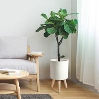 Simple round magma flower pot black white wooden leg elevated flower pot planting living room decoration