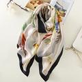 The new elegance temperament women silk scarf towel feather Parrot print beach towel scarf female sunscreen decoration gift