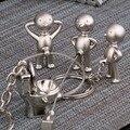 1 пара Closestool автомобильный брелок забавные Matal Пи мальчик брелок с унитазом CPAM Подарочный Брелок для ключей - фото