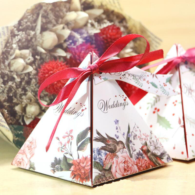 Us 10 02 5 Off 20pcs Lot Wedding Decoration Pyramid Candy Box Letter Flower Print Engagement Sweet Box Wedding Favor And Gift Box In Gift Bags