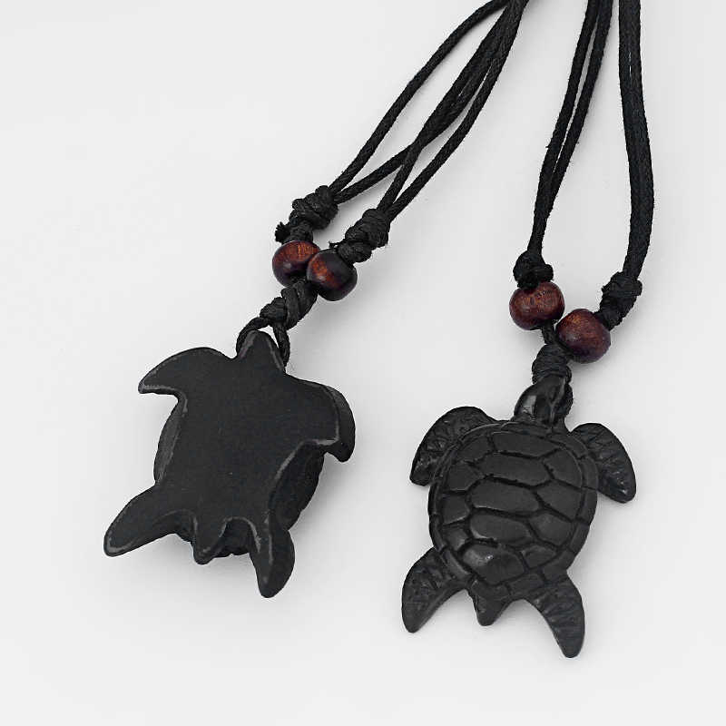 Protection. Turtle Pendant made of resin on black cotton cord Adjustable length; choker to long Necklace Symbol: Strength Unisex