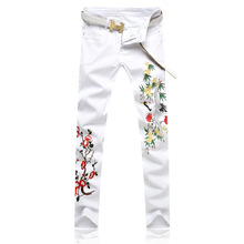 Embroidered jeans spring and summer white bird pattern embroidery men's trousers autumn slim feet personality pants men newspapers pattern narrow feet jeans