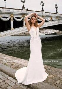 Image 3 - Profundo decote em v corpete duplo em camadas sereia vestido de casamento com trem destacável ilusão tatuagem estilo voltar vestido de noiva