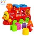 Huile Brinquedos 8810 Brinquedos Do Bebê Bump and Go Ação de Aprendizagem Luzes de trem e Bloco de Música Letras Classificador de Forma Brinquedos Educativos presentes