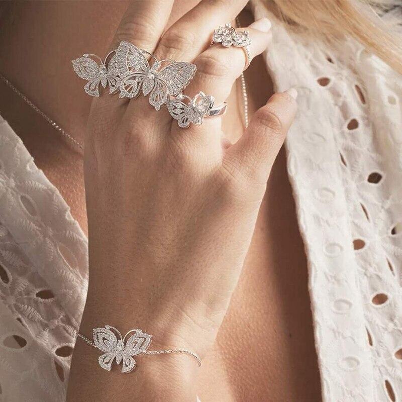 Takı ve Aksesuarları'ten Nişan Yüzükleri'de Yeni Varış Saf 925 Ayar Gümüş Zirkon Kelebek Çiçek Üç Parmak manşet yüzük JUILLET Kadınlar düğün takısı'da  Grup 1