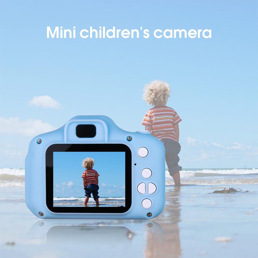 HTB1J2R6d8Cw3KVjSZR0q6zcUpXa9 Kebidu new Mini HD Cartoon Kids Camera Taking Pictures Language game Digital Photo Camera HD gifts for boys and girls
