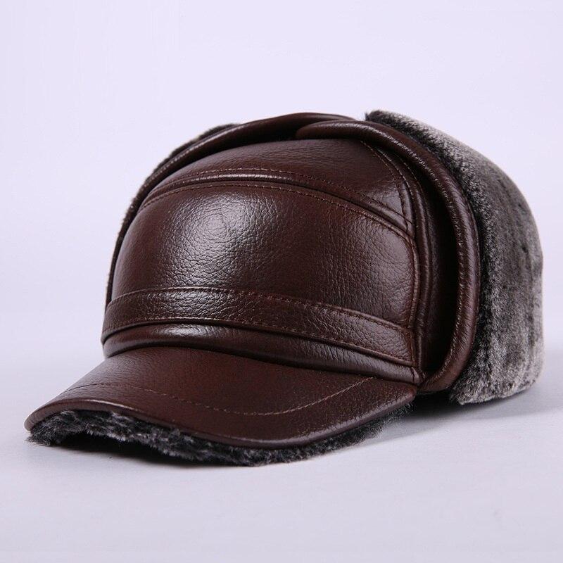 2017 nuevos hombres orejeras de cuero genuino sombrero de hombre de piel de  imitación Gorras de béisbol espesar caliente plana sombreros de piel de  vaca ... 95ecf54ec6c