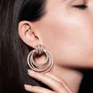 Image 2 - GODKI luksusowe Twist koło Dangle kolczyki dla kobiet ślubne sześciennych cyrkon kryształ CZ Dubai Bridal kolczyk moda biżuteria 2019