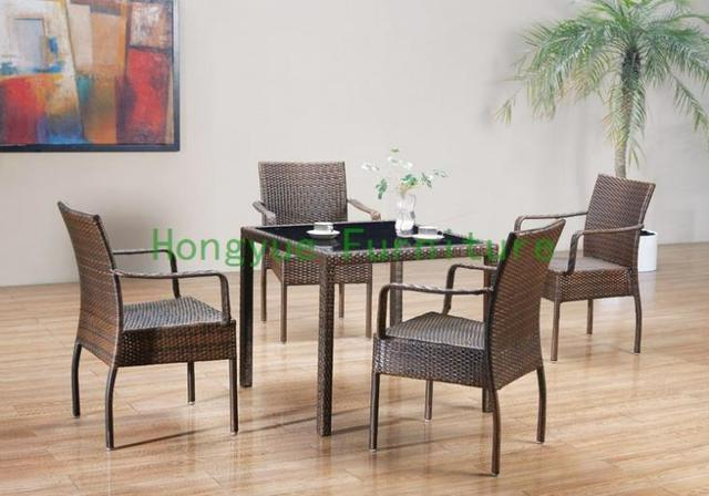 Outdoor new pe rattan dining chairs with tempered glass