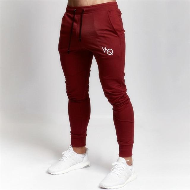 Homens Corredores Sweatpants algodão Outono Inverno slim fit calças de Fitness Musculação academias Calças Lápis marca de moda Casual Sólidos