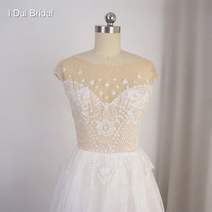 Image 3 - Cap Sleeve Sparkle Wedding Dress with Organza Ruffles Illusion Neckline Shinny Bridal Gown