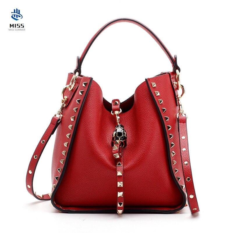 2019 nouveau sac de femmes de luxe en cuir de vache design rivet sac à main léopard tête épaule messenger sac de haute qualité seau sac