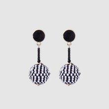 Black and white beaded earrings in modern fashion