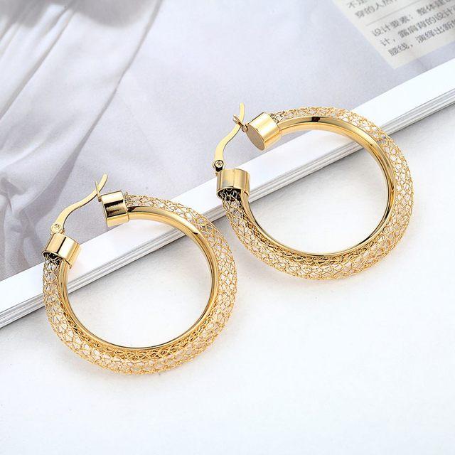 Фото женские ажурные серьги кольца модные брендовые золотого цвета цена