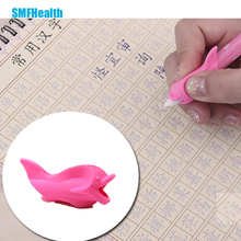 Student writing posture corrective braces to hold a pen device dolphin fish gel pencil hold