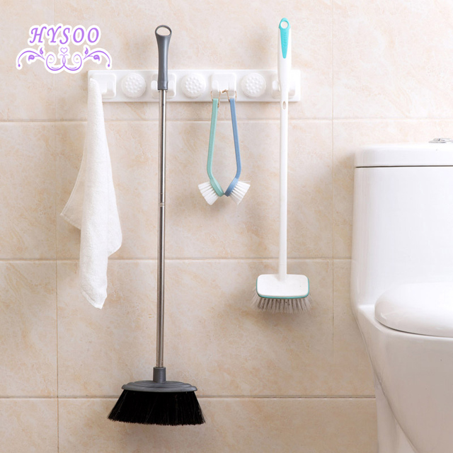 towel storage rack. Powerful Sucker Mop Hooks Bathroom Free Punching Towel Broom Storage Rack