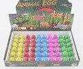 Gadget de la novedad Pequeño magia grow huevo de dinosaurio de juguete de agua juguetes para niños educativos de incubación de huevos de dinosaurio huevo sorpresa agua