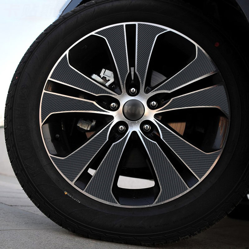 Autocollant noir de moyeu de roue de vinyle de FIBER de carbone de style de voiture adapté pour KIA SPORTAGE R 2010-2015 accessoires extérieurs (pour des roues de 18 ')