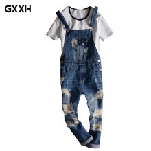 52d34c0293e 2018 New Male Suspenders New Casual Light Blue Denim Overalls Ripped Jeans  Pockets Men s Bib Jeans