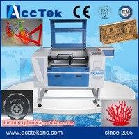 Jinan Acctek 60w/80w glass co2 laser tube small co2 laser engraving machine/mini laser engraver 6040/6090 cheap price
