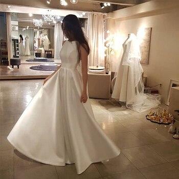 e388a04c0 Longitud piso Simple De la boda Vestido De cuello De satén sin mangas  Vestido De Novia blanco marfil coreano mujeres elegante a-línea Vestido De  Novia