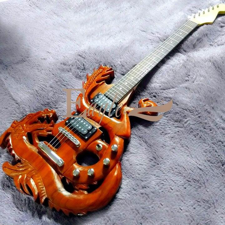 Aigle. Papillon guitare basse personnalisé boutique chine dragon guitare électrique sculpture à la main haute personnalisation personnalisé en forme de bricolage électrique