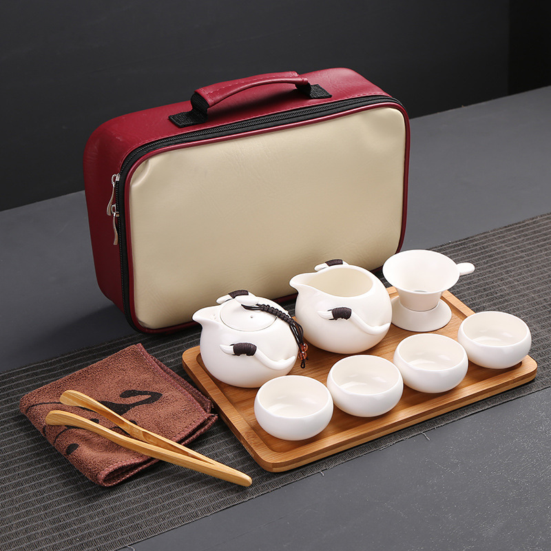 A pot of four cups of tea set Ding travel bag special offer Ceramic Teapot manufacturers selling customized logo